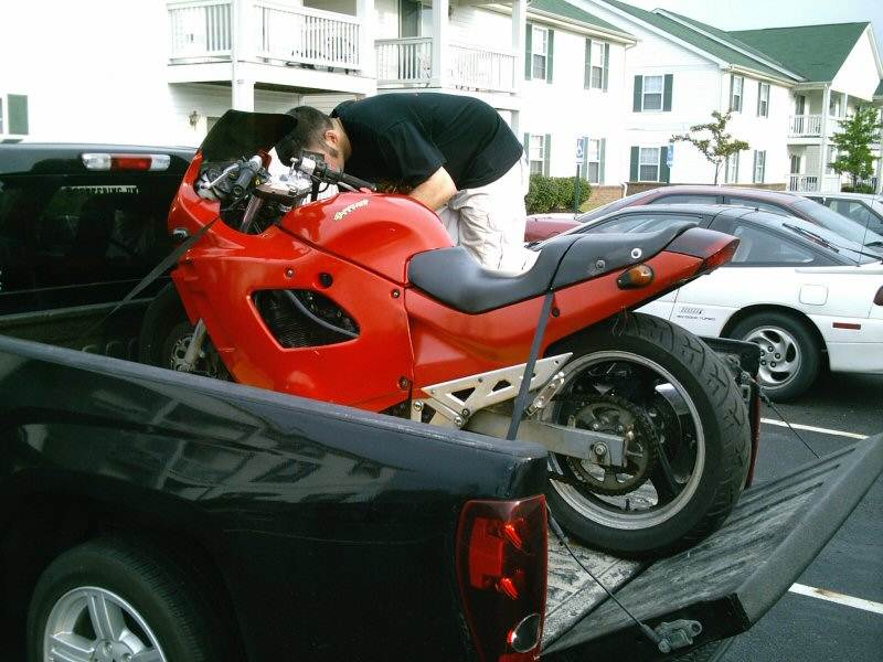 Proper way to strap down a motorcycle in the bed of a ...